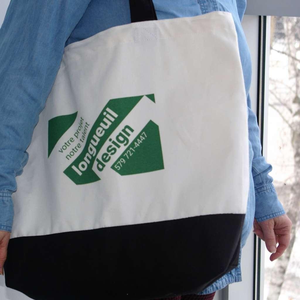 Sac en coton avec une image promotionnelle de Longueuil Design.