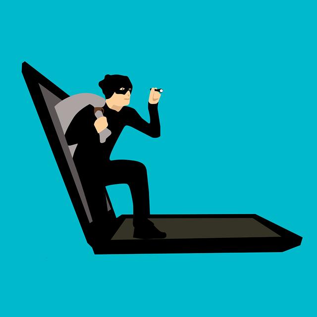 Voleur sortant d'un écran d'ordinateur